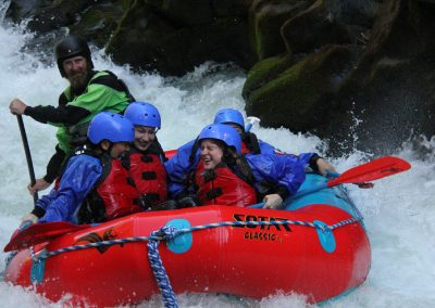 Group of rafters laughing after getting splashed from a rapid on the upper gorge White Salmon.