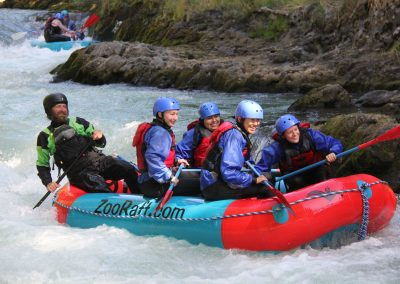 Group of four rafting smiling while on the white salmon river