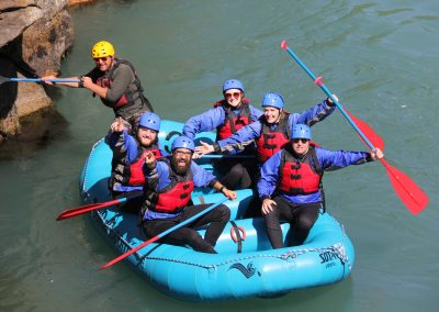 A group of rafters posing for the camera while on the White Salmon middle gorge.