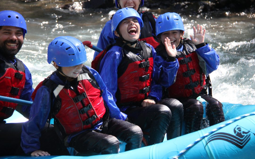kids laughing while in their raft down the middle gorge