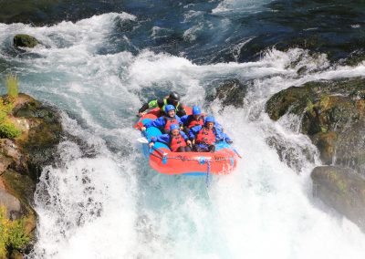 Group of four in a mini raft going down Husum Falls.