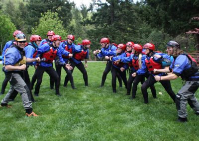 """Two teams of rafters wearing face paint """"facing off"""" against each other."""
