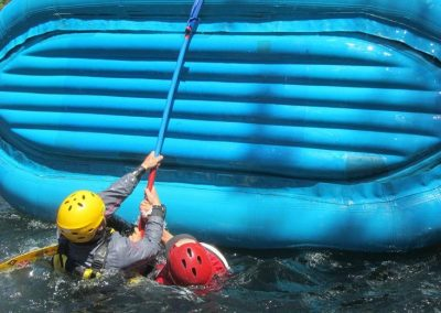 whitewater rafting guide school raft flipping